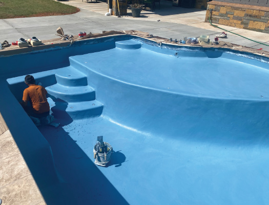Grotto Pool Designs working on a pool remodel